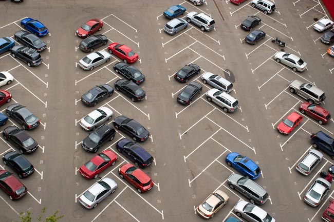 Aerial view of a parking lot with many cars parked